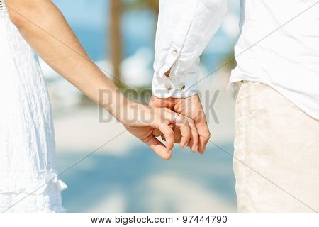 Concept Shoot Of Love Of Man And Woman: Two Hands Over Waterfront
