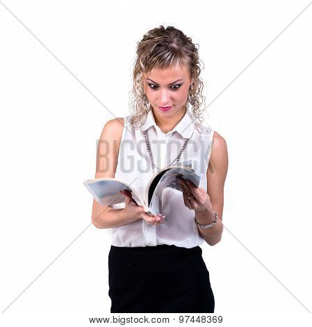 happy female student flipping a book, isolated on white background