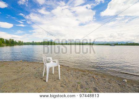 White Lawn Chair On Beach