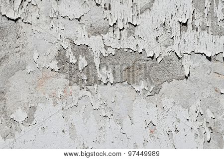 Vintage Flakes Of Old White Paint Over Grey Concrete Wall