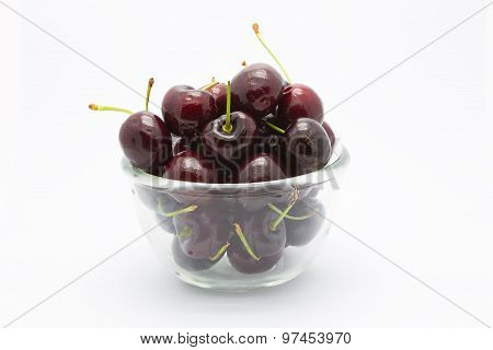 Juicy red cherries on white background