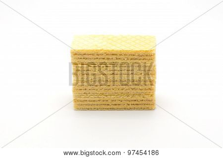 Pile of wafers with cream on white background
