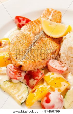 fish steak wit rice and vegetables