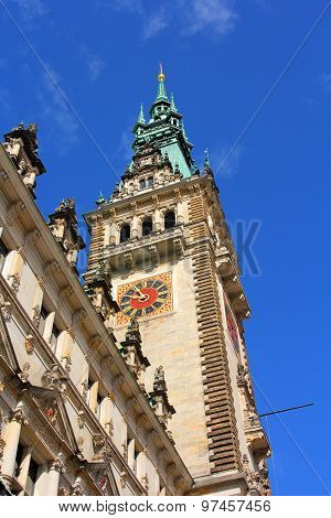 The Tower Of An Old Building With A Clock