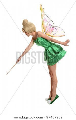 Young woman dressed in mythological being using magic wand