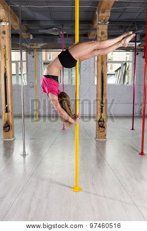 Pole Dancer Doing Complicated Figure