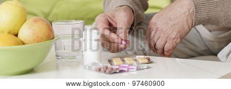 Elder Man Taking Remedy