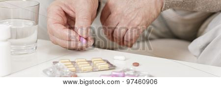 Ill Person Taking Medicine