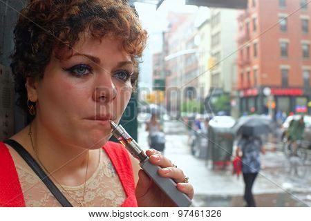 Young woman with electronic cigarette