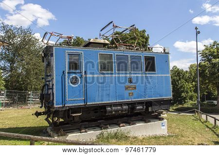 Munich, Germany - July 30, 2015:  The Bayerische Zugspitzbahn (Bavarian Zugspitze Railway) is located in the alps and the locomotives are exposed in Munich
