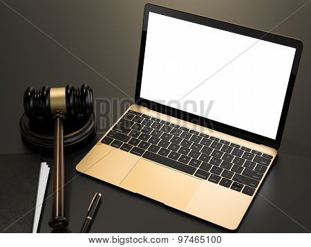 Wooden Judges Gavel And Laptop Computer On Black Table