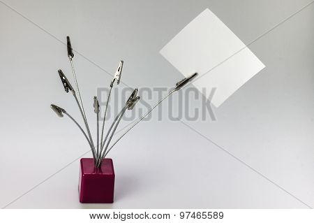Metal Clips With Blank Paper Note, Background For And Any Important Information.