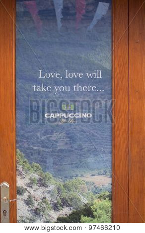 Advertisement On Glass Door By Cappuccino Café