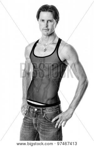 Man in mesh tank top and jeans. Studio shot over white. Black and white.