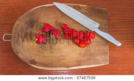 Red strawberries on a cutting board