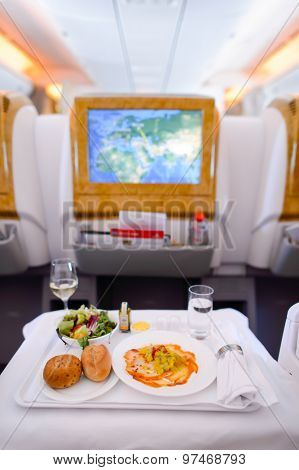 DUBAI - JUNE 23, 2015: Emirates Boeing 777 busines class interior. Emirates handles major part of passenger traffic and aircraft movements at the airport.
