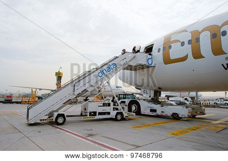 DUBAI, UAE - JUNE 23, 2015: passengers boarding the Emirates Boeing 777-300ER. Emirates handles major part of passenger traffic and aircraft movements at the airport.