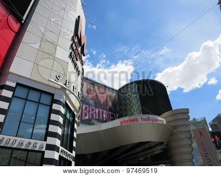 Planet Hollywood Hotel Miracle Mile With Britney Spears Ad And Cloudy Sky