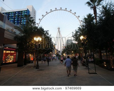 People Explore The Linq The Shopping And Dining Area Leading Up To The High Roller Wheel