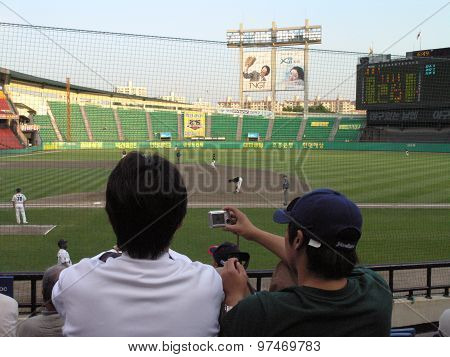 Fan Photographs Baseball Game With Digital Camera