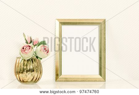 Picture mockup with golden frame amd flowers. Vintage style toned picture