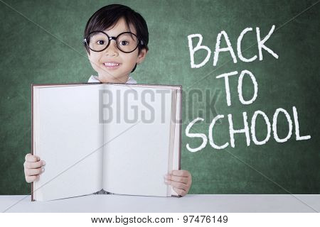 Child Back To School And Show Empty Book