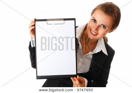 smiling modern business woman holding blank clipboard