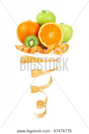 Fruits for diet and measuring tape isolated on white