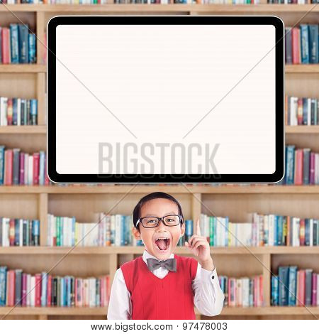 Excited Little Schoolboy In Library