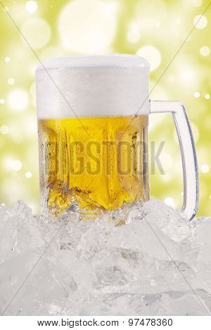 Frothy Beer In The Glass With Bokeh Background