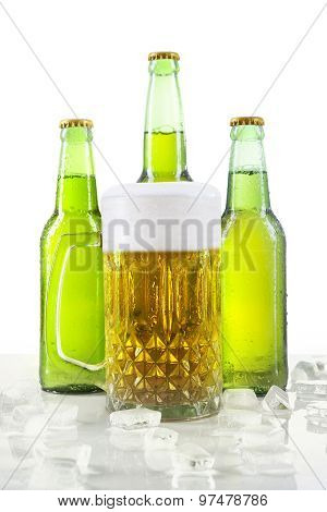 Lager With Foam In The Glass And Bottles