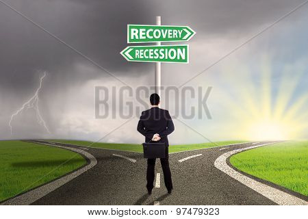 Man Choosing The Road To Recovery Or Recession Finance
