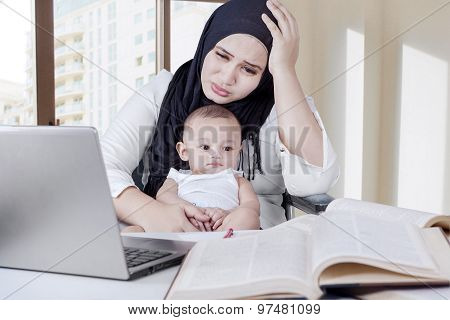 Tired Mother Working With Her Kid