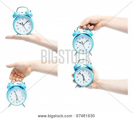 Caucasian male hand holding alarm clock