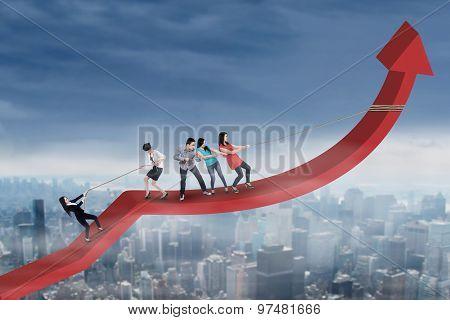 Young Entrepreneurs Pulling Profit Graph