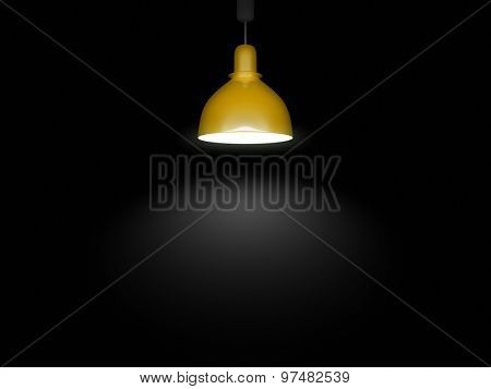 An image of a yellow lamp in front of a black background