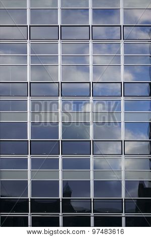 Facade with clouds reflections