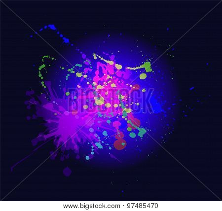 Colorful paint splashing on dark blue background