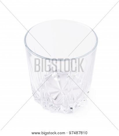 Empty whiskey tumbler glass isolated