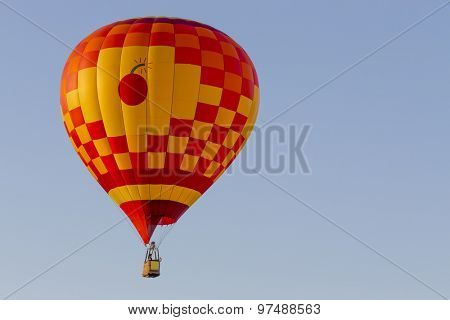 Colorful hot air balloons against a blue sunset sky
