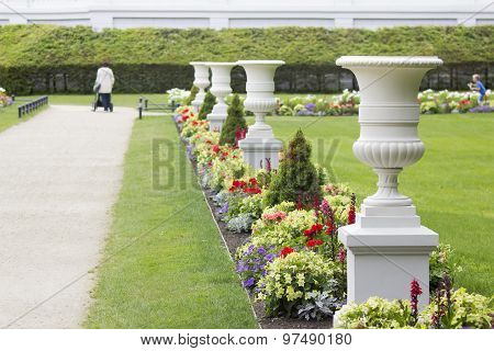 White Antique Vases In A Resort Park