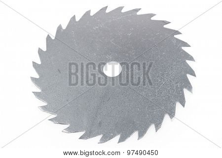 Circular saw blade on plain background