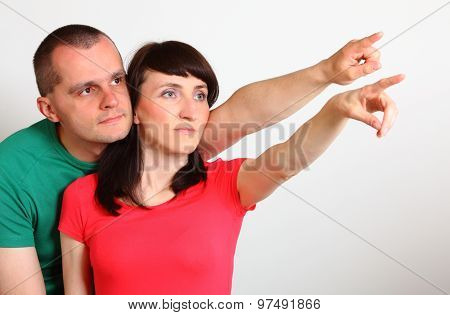 Serious Couple Looking And Pointing Into Distance