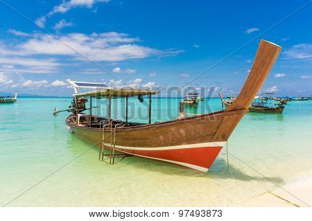Longtail Wood Boat And Islands In Andaman Sea