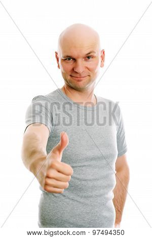 Man With Bald Head And Thumb Up Is Looking Friendly In To The Camera