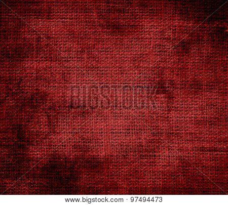 Grunge background of deep maroon burlap texture