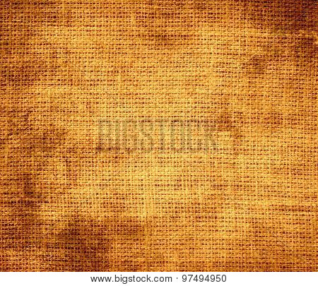 Grunge background of deep saffron burlap texture