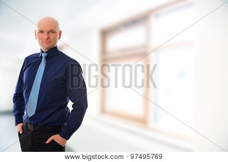 Businessman With Bald Head In Front Of White Background