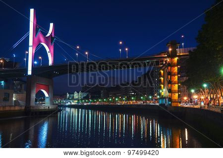 Salbeko zubia Bridge over Nevion River in Bilbao, Spain at night