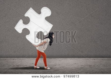 Female Student Bring Puzzle On Grey